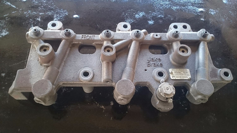 JAKE BRAKE UNIT, MODEL 797B FROM A DETROIT DIESEL 12.7L, S60 ENGINE.